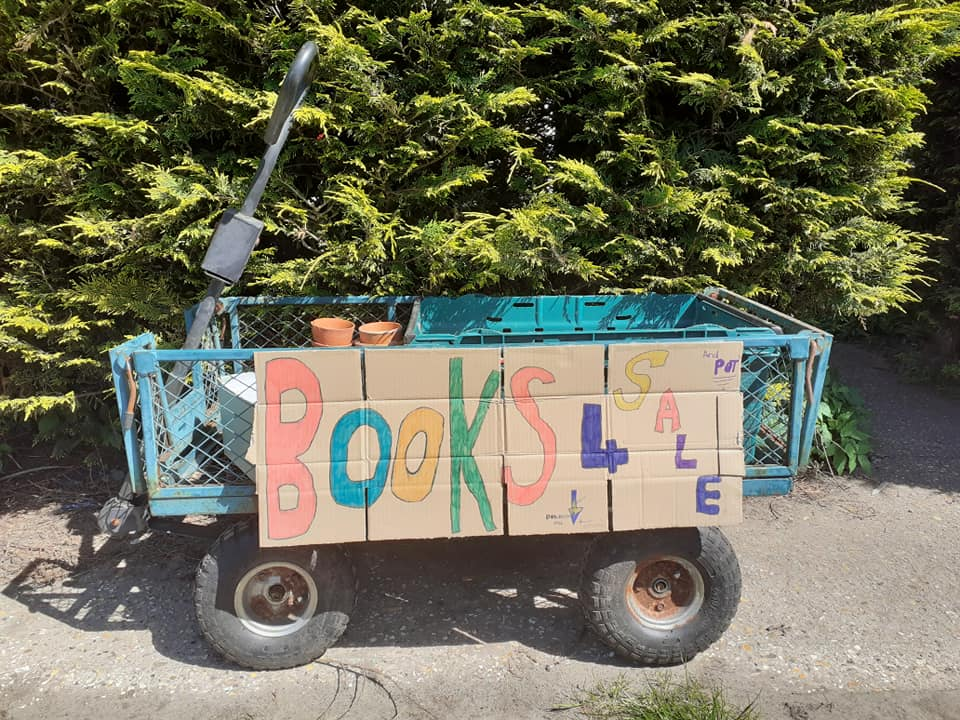 photo of a cart filled with books for sale reclaiming my home office